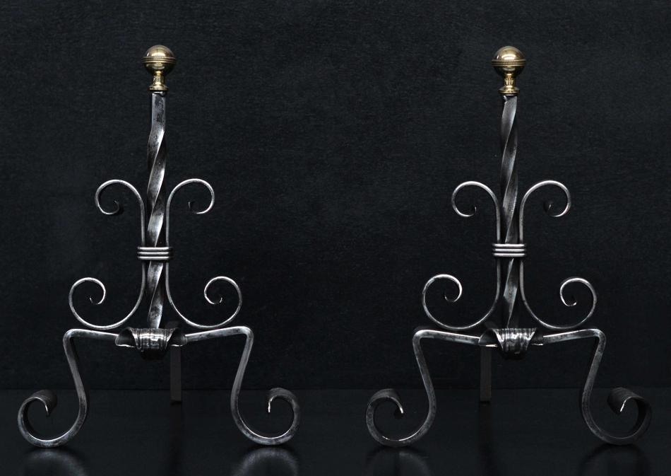 A pair of polished steel French firedogs