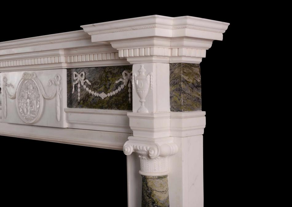 A Statuary marble fireplace with Connemara columns