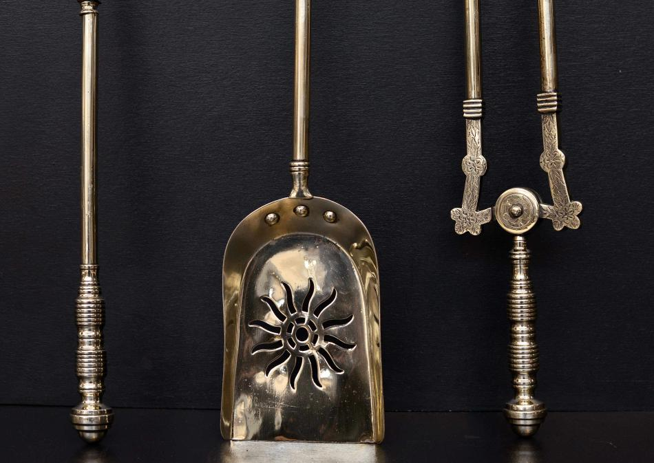 A set of late 19th century brass firetools 26 inch