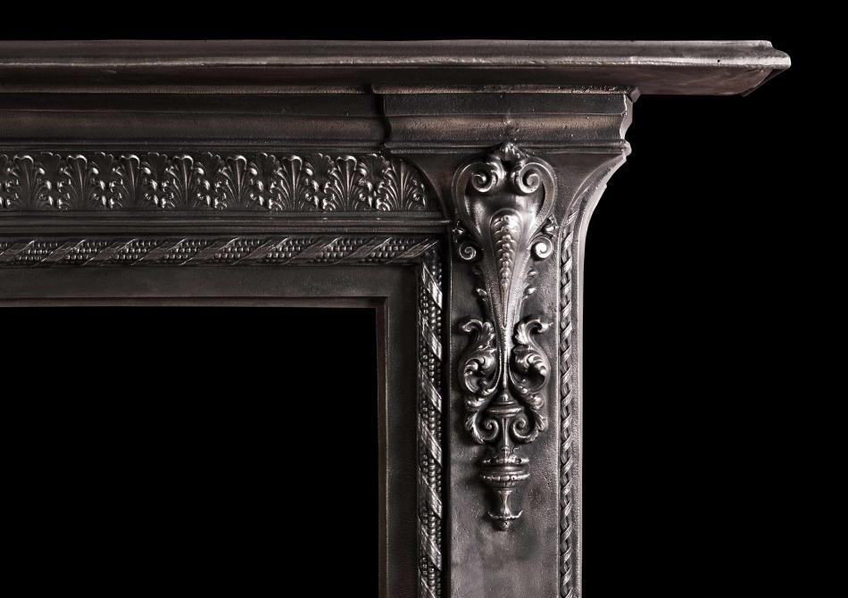 A mid 19th century English cast iron fireplace.