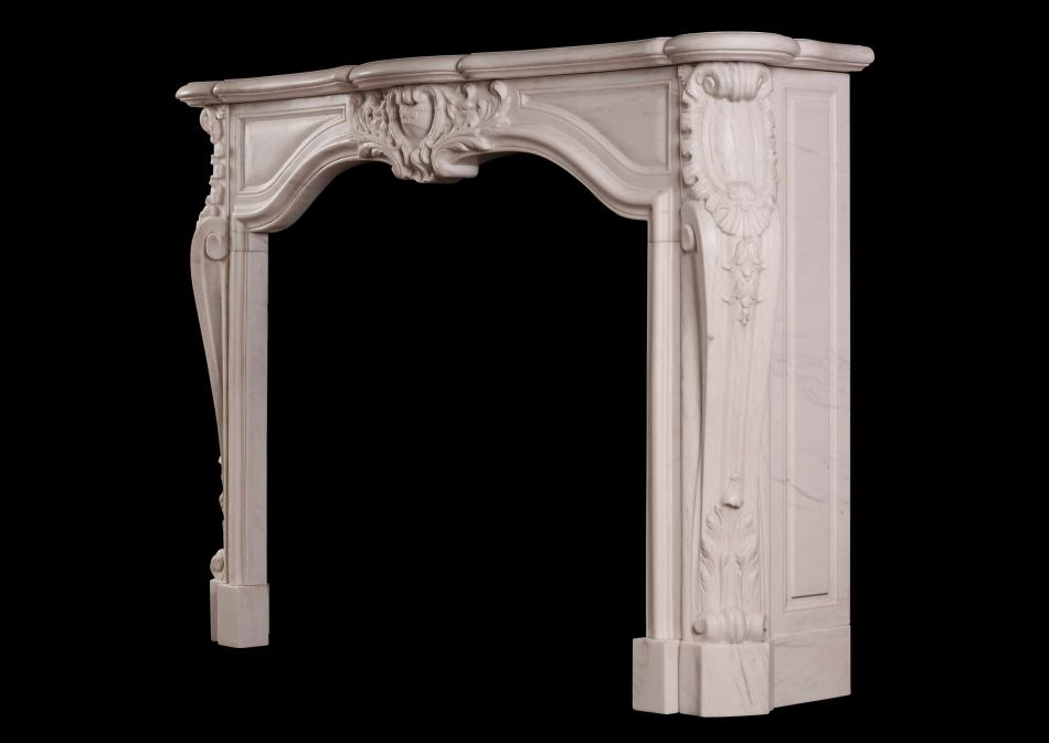 A French transitional Louis XIV/XV marble fireplace