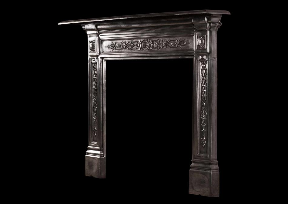 A small late Victorian cast iron fireplace