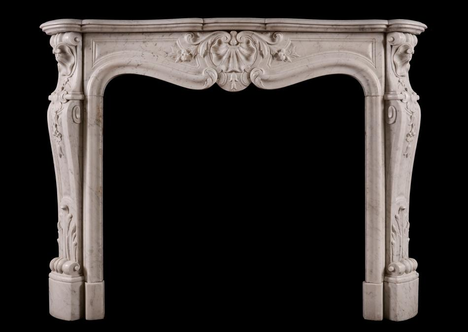 A French Louis XV style Carrara marble fireplace