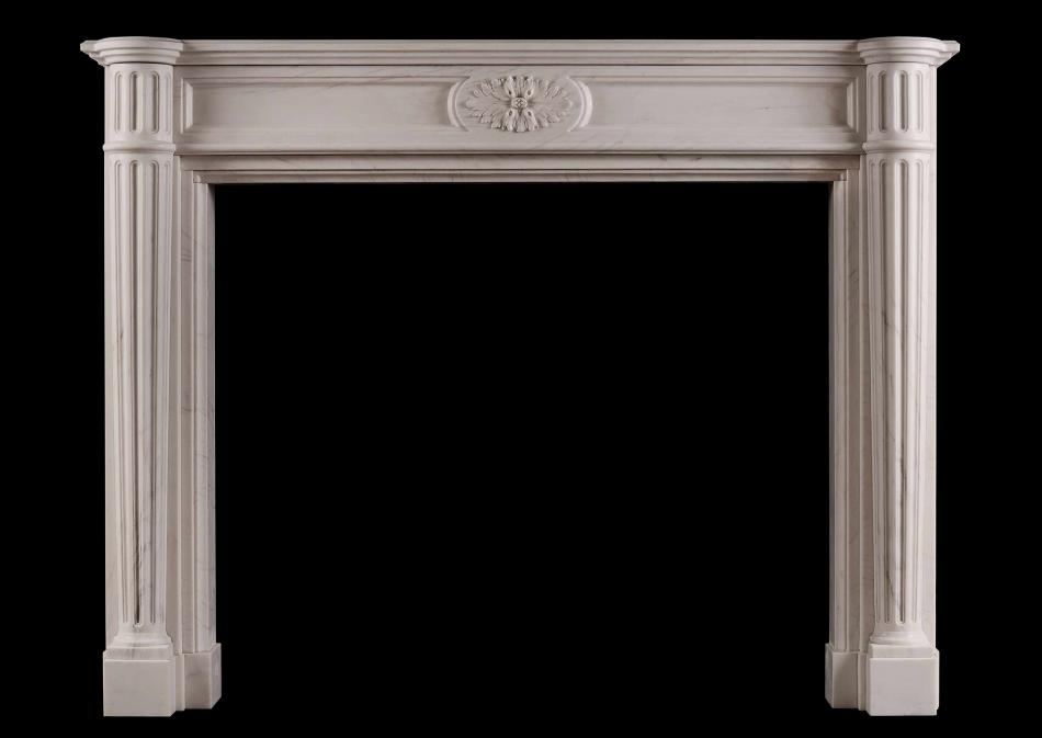 A French Louis XVI style white marble fireplace