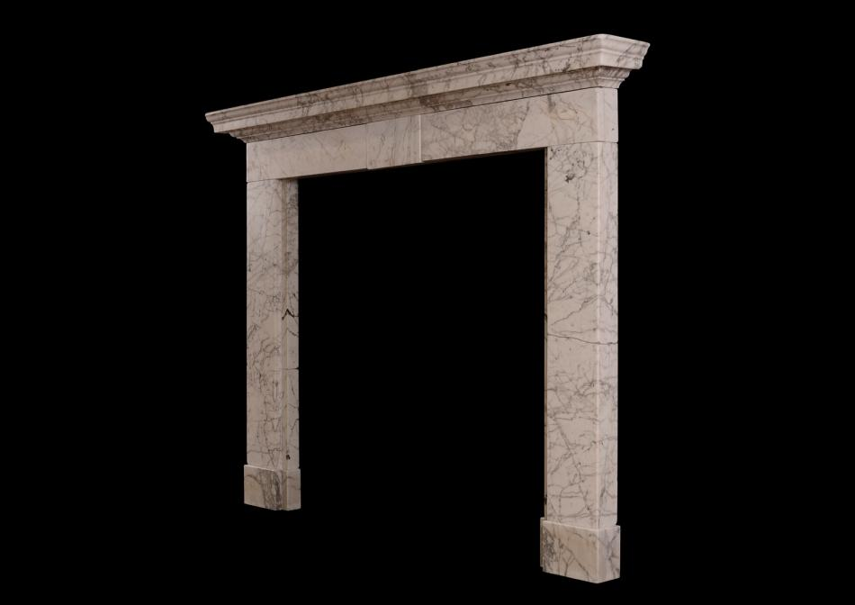 An early Georgian fireplace in heavily veined Statuary marble