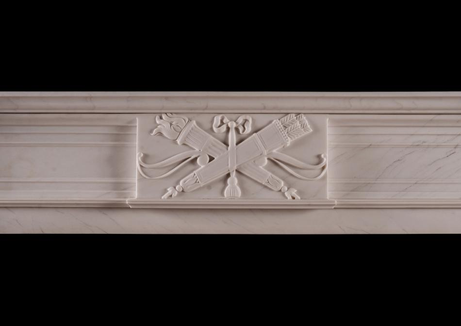 A white marble fireplace in the late Georgian manner