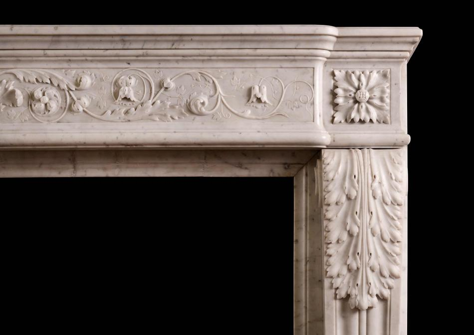 A finely carved Louis XVI style marble fireplace