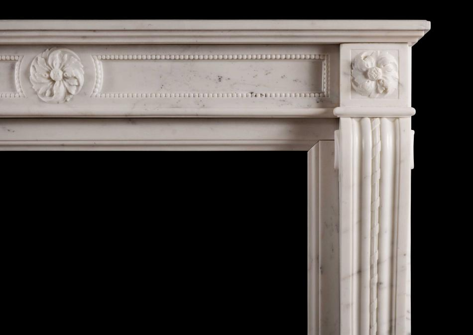 A Statuary marble antique fireplace in the Louis XVI manner