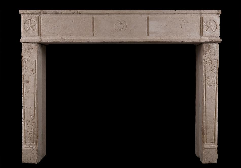 A period 18th century Caen stone fireplace
