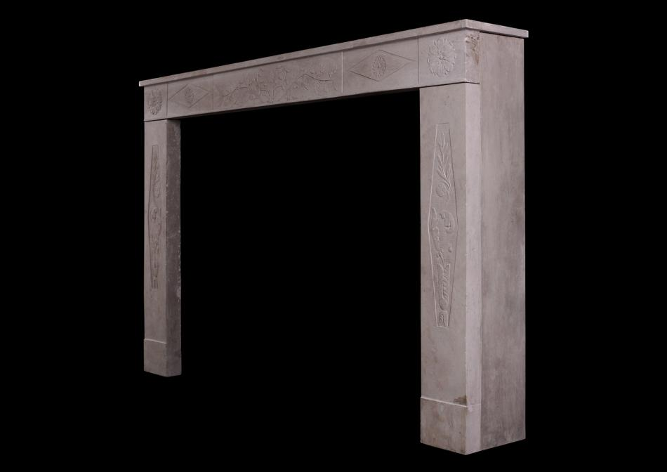 A 19th century French limestone fireplace