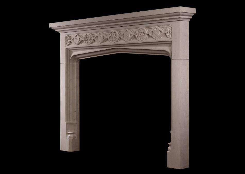 A Gothic style limestone fireplace