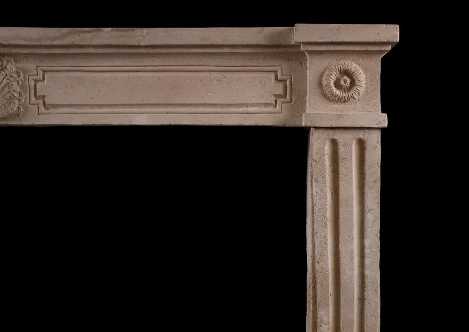 A rustic French Louis XVI antique fireplace