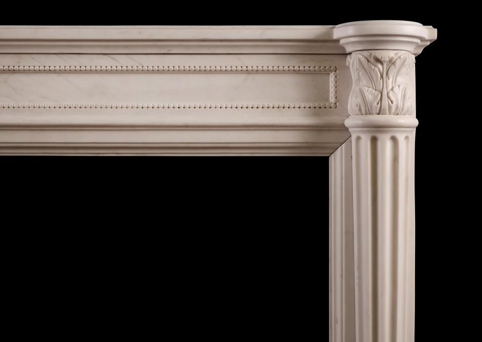 A white marble fireplace in the Louis XVI manner