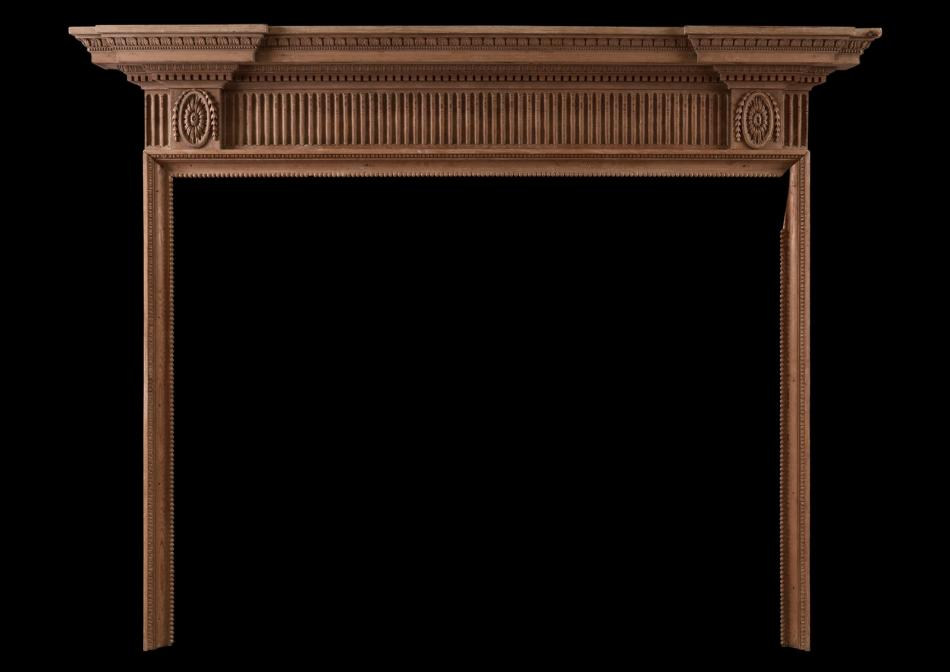 A finely carved English wood fireplace