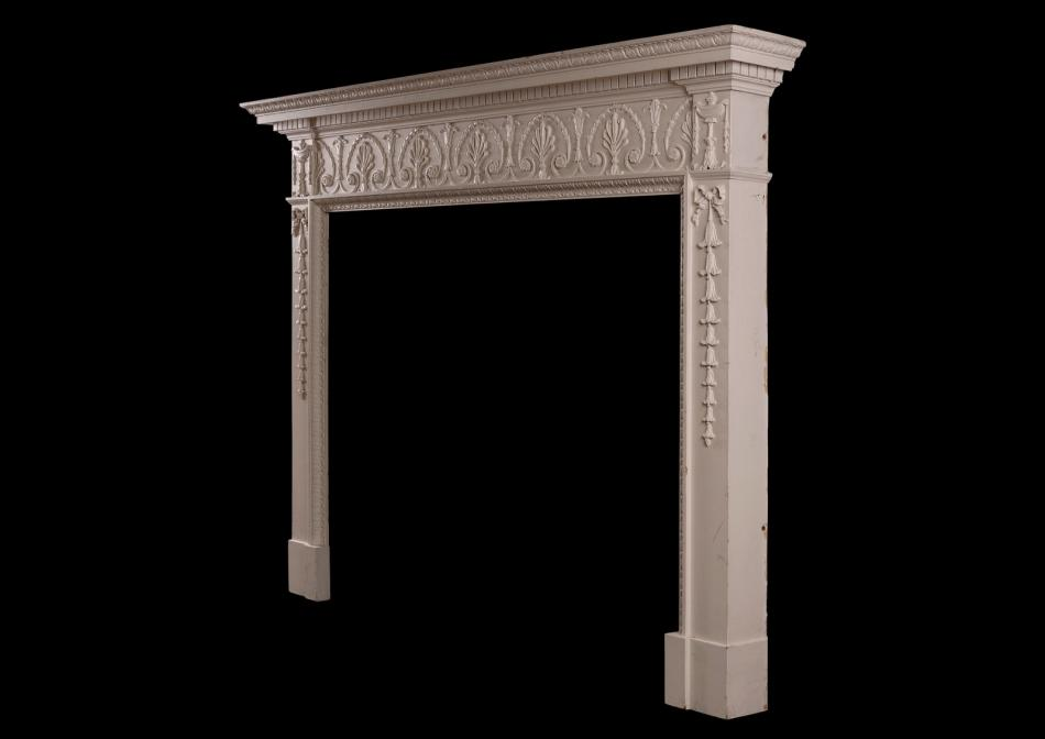 An English wood fireplace in the George III style