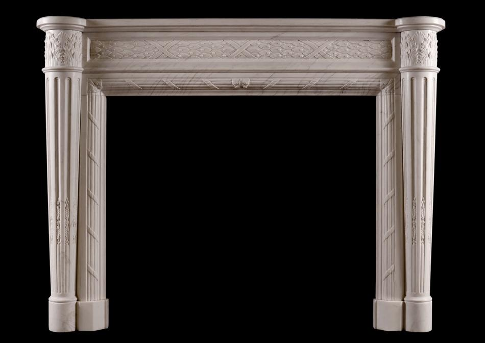 A Louis XVI style marble fireplace with tapering columns