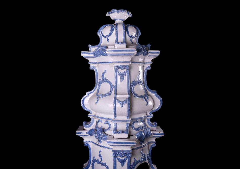 An ornate ceramic Kachelofen stove