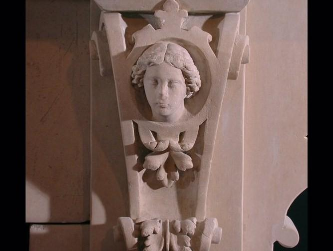 A 19th century English carved limestone fireplace in the Gothic taste