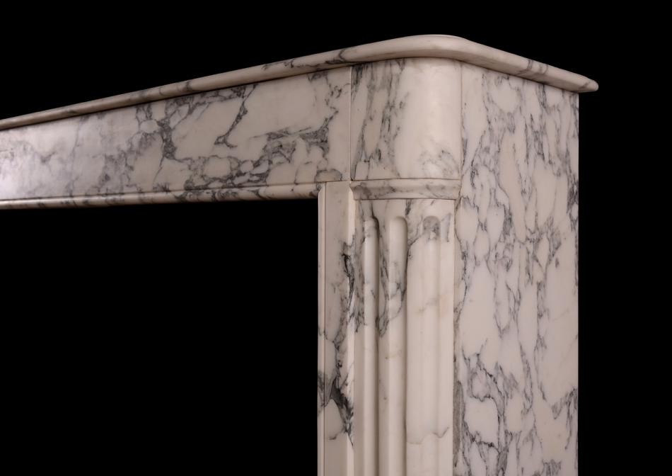 An architectural French Louis XVI style marble fireplace