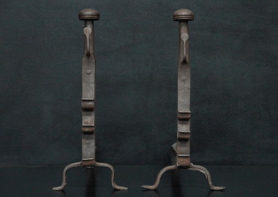 A pair of wrought iron firedogs