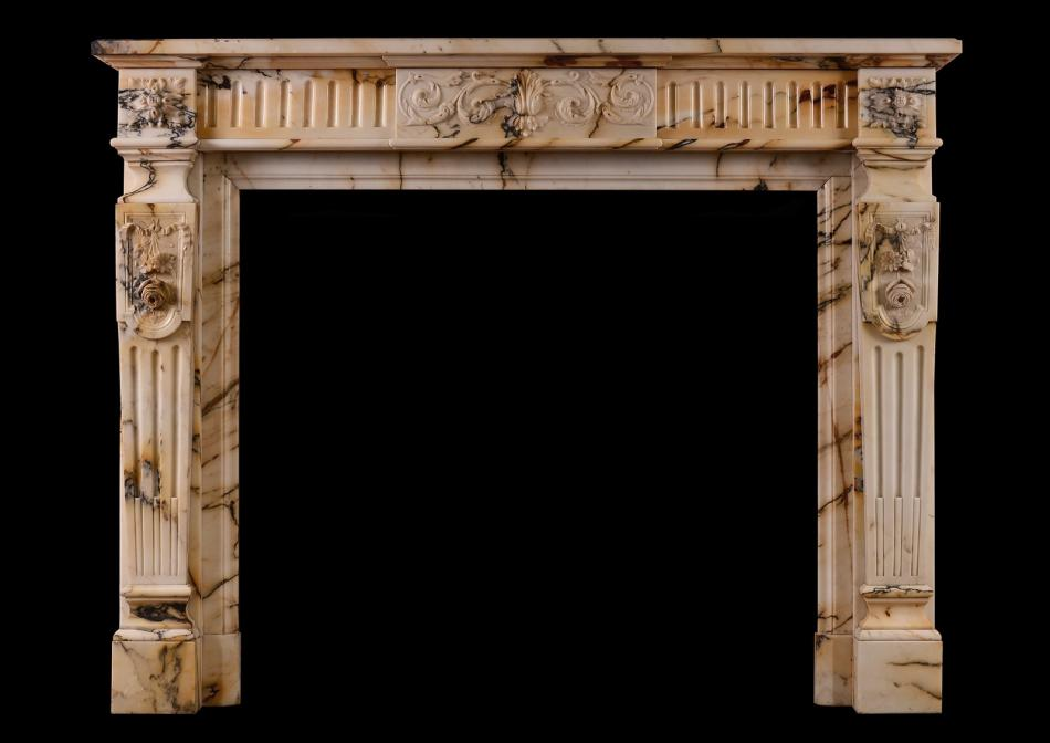 A French Louis XVI style Pavonazzo marble antique fireplace