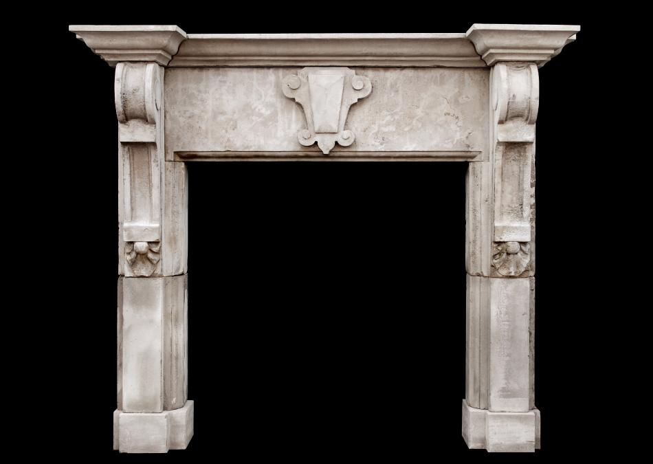 A large limestone fireplace with shaped brackets (pair available)
