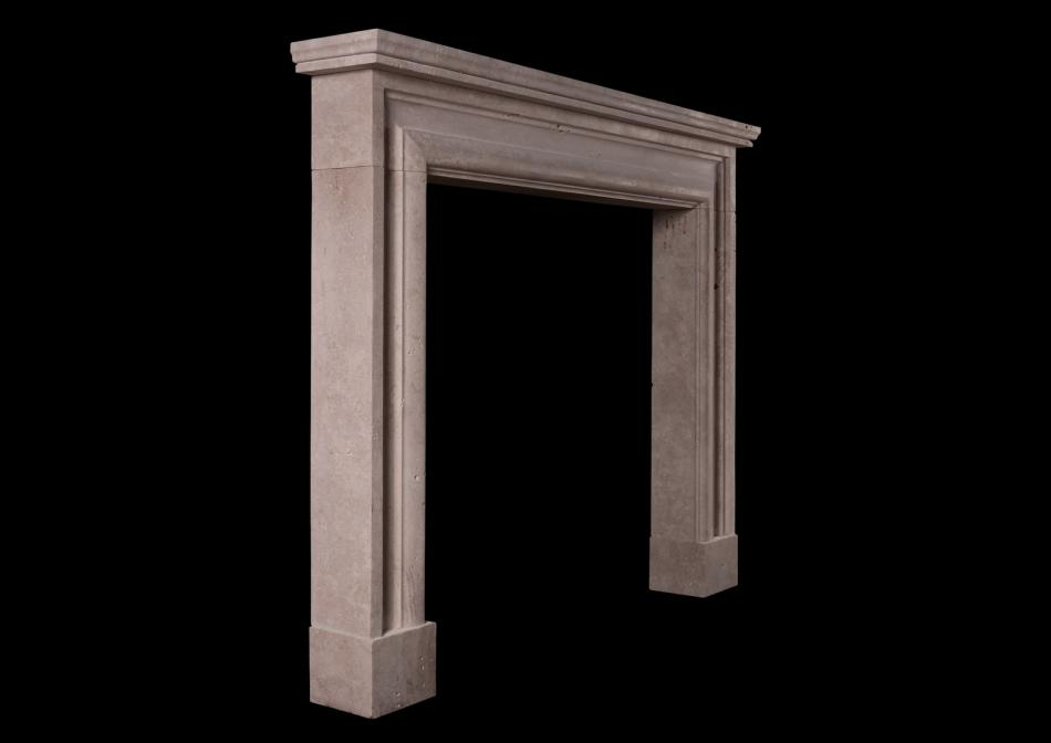 An English bolection fireplace in Travertine stone