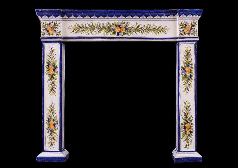 A painted ceramic fireplace of small scale