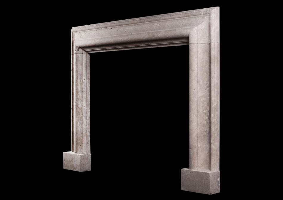A large English moulded bolection fireplace in white Travertine