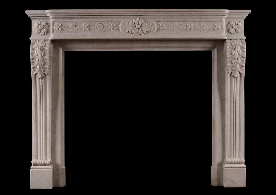A French Louis XVI style marble fireplace in Carrara marble