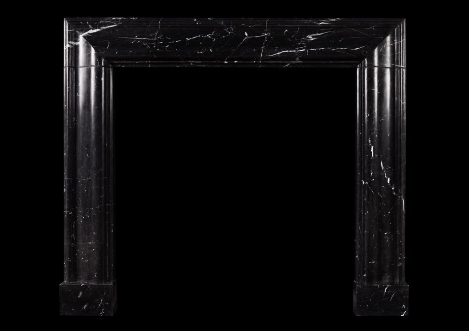 A English moulded bolection fireplace in Nero Marquina marble