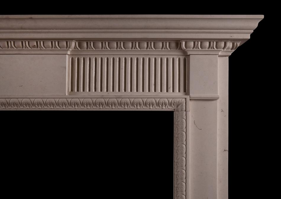 A limestone fireplace in the late Georgian manner