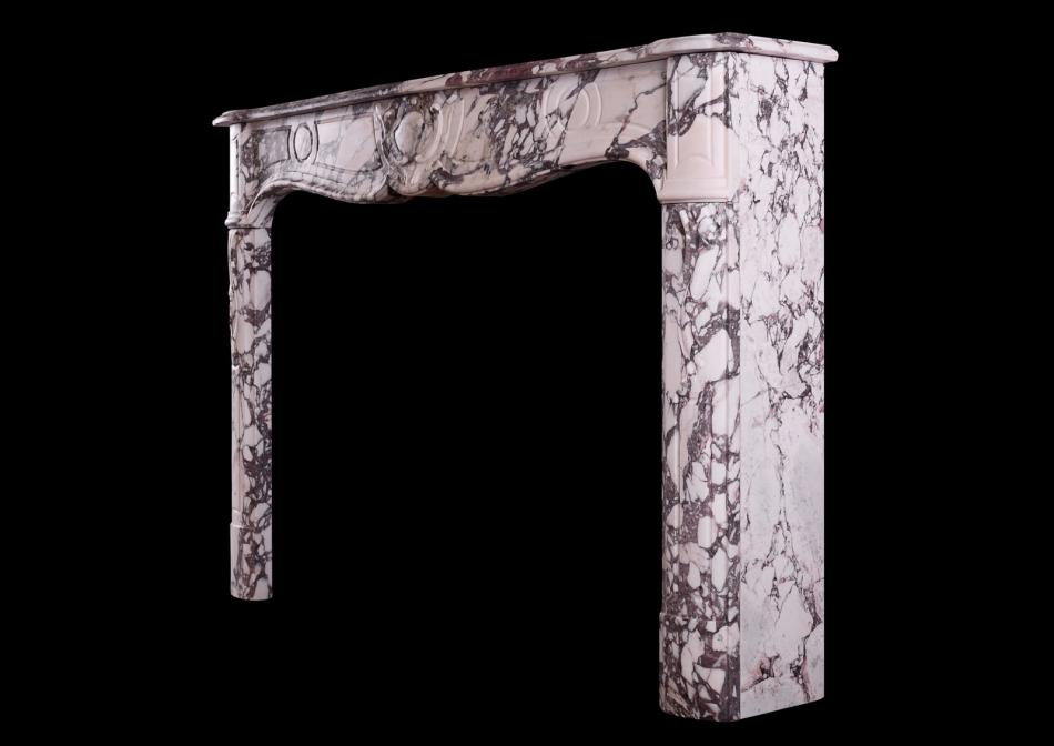 A French Provencale fireplace in Breche Violette marble