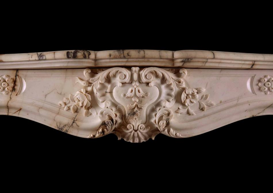 A fine quality French Louis XV style fireplace in Pavonazzo marble