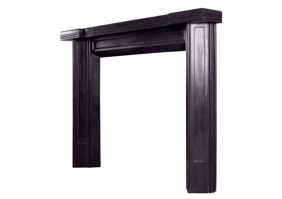 A black marble Art Deco style fireplace