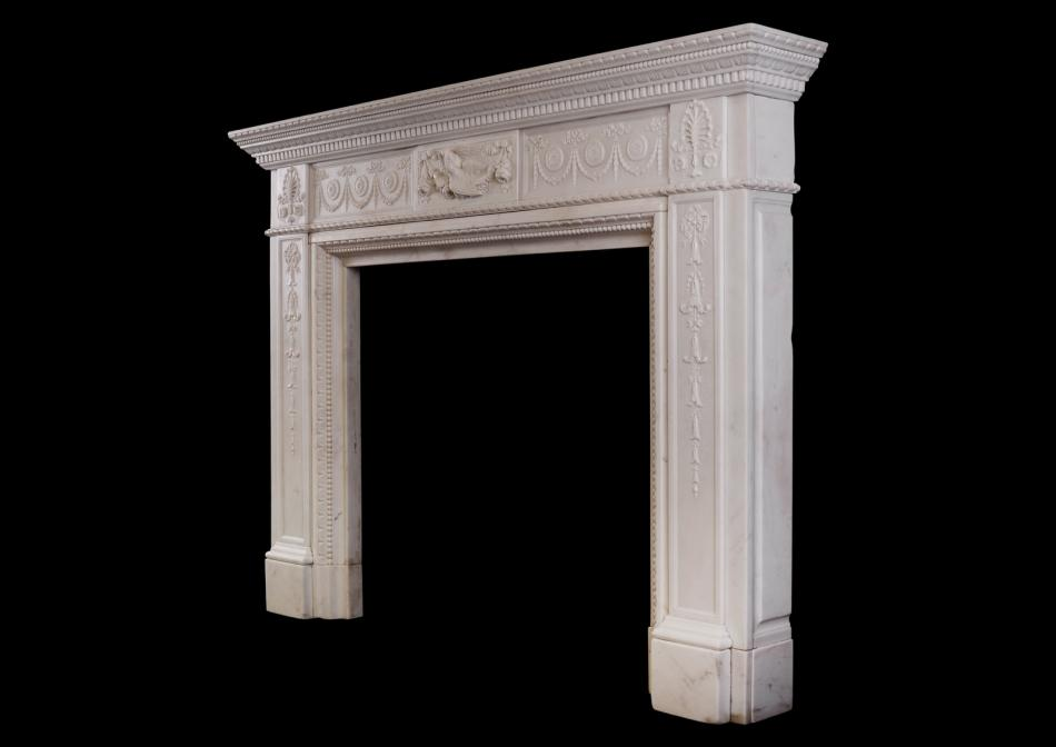 A finely carved Statuary marble fireplace with birds to centre block