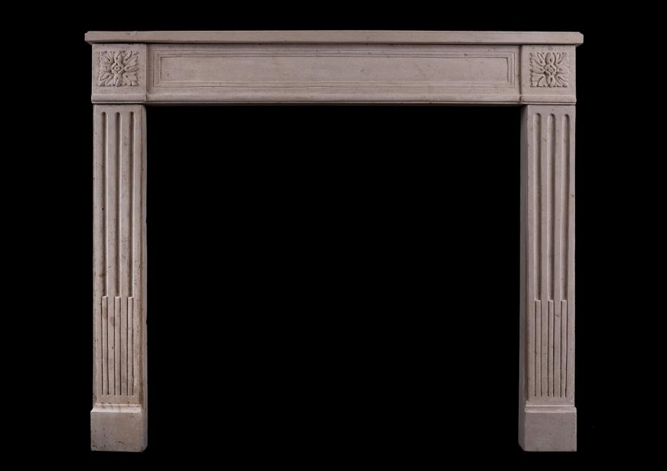A French stone fireplace in the Louis XVI style