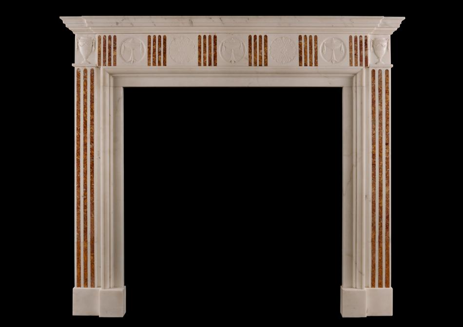 A Regency style marble fireplace with Sienna Brocatelle inlay