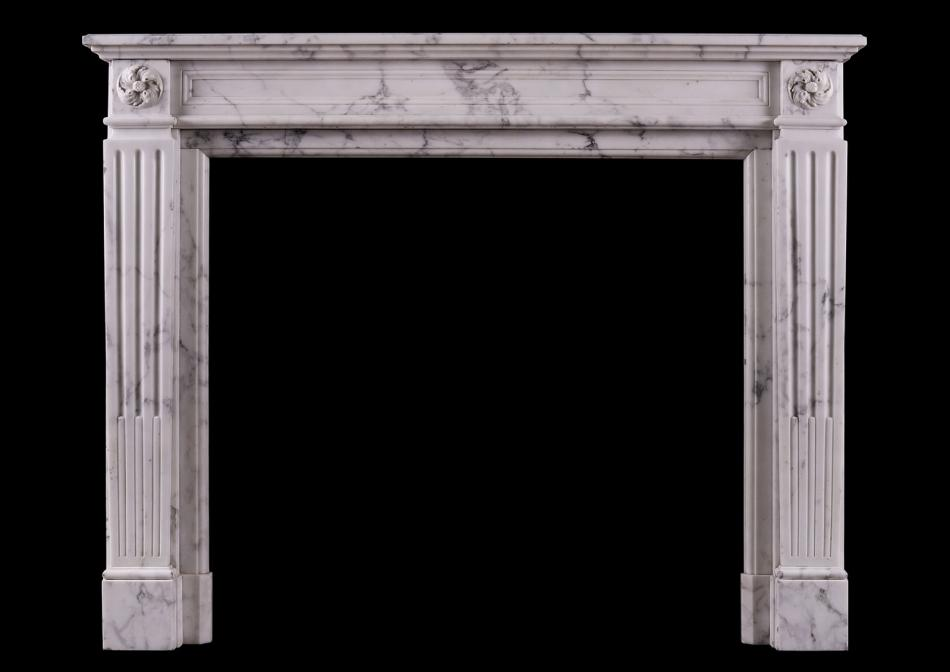 A veined Statuary Louis XVI style marble fireplace