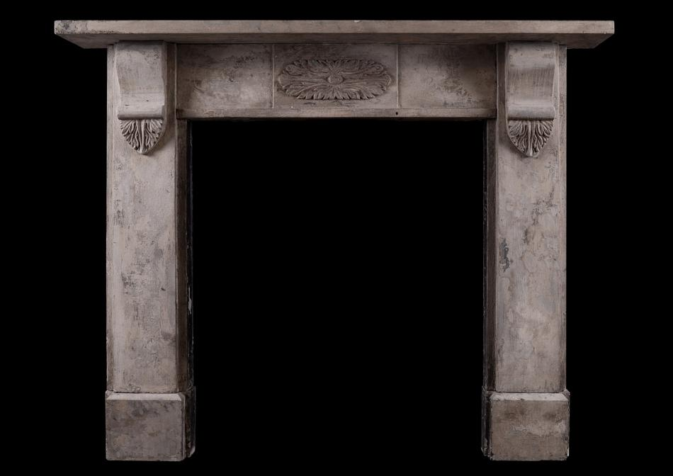 A Cotswold limestone mid 19th century fireplace