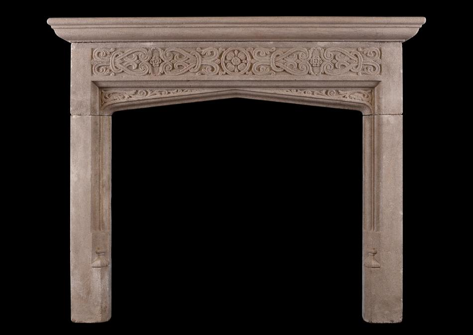 A Neo-Gothic carved bath stone fireplace