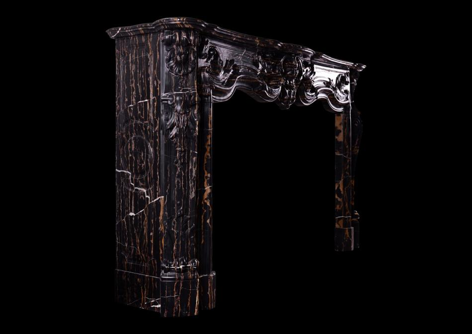 A striking Louis XV style marble fireplace