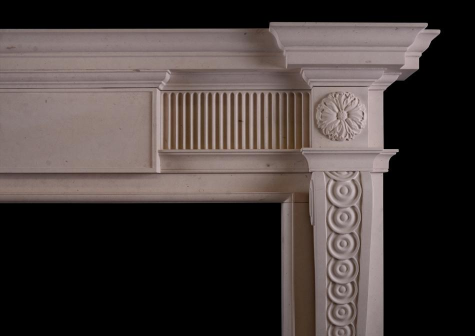 A George II style Lincoln stone fireplace