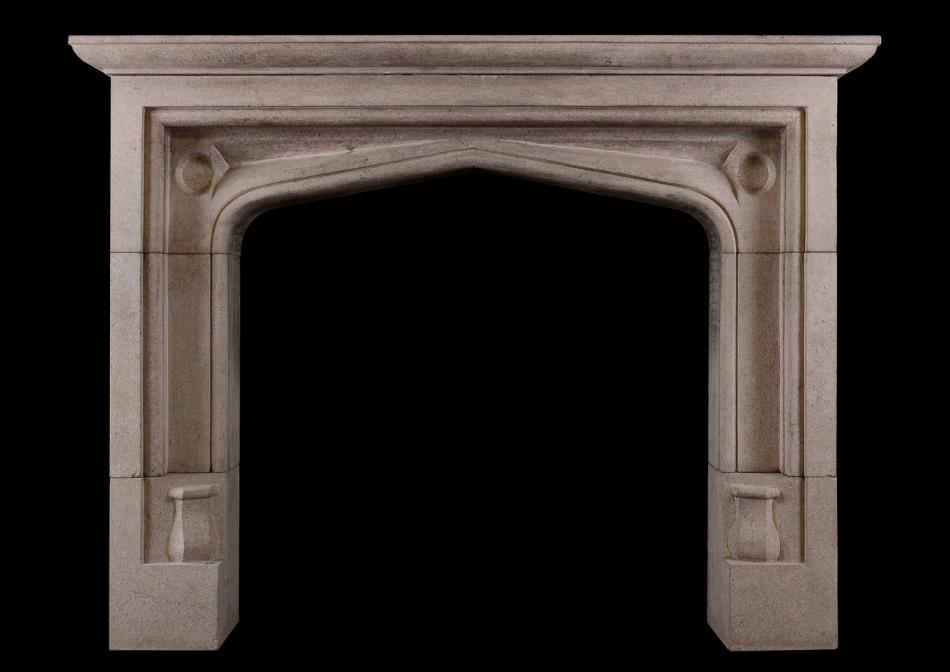 A Bath stone fireplace in the Gothic manner