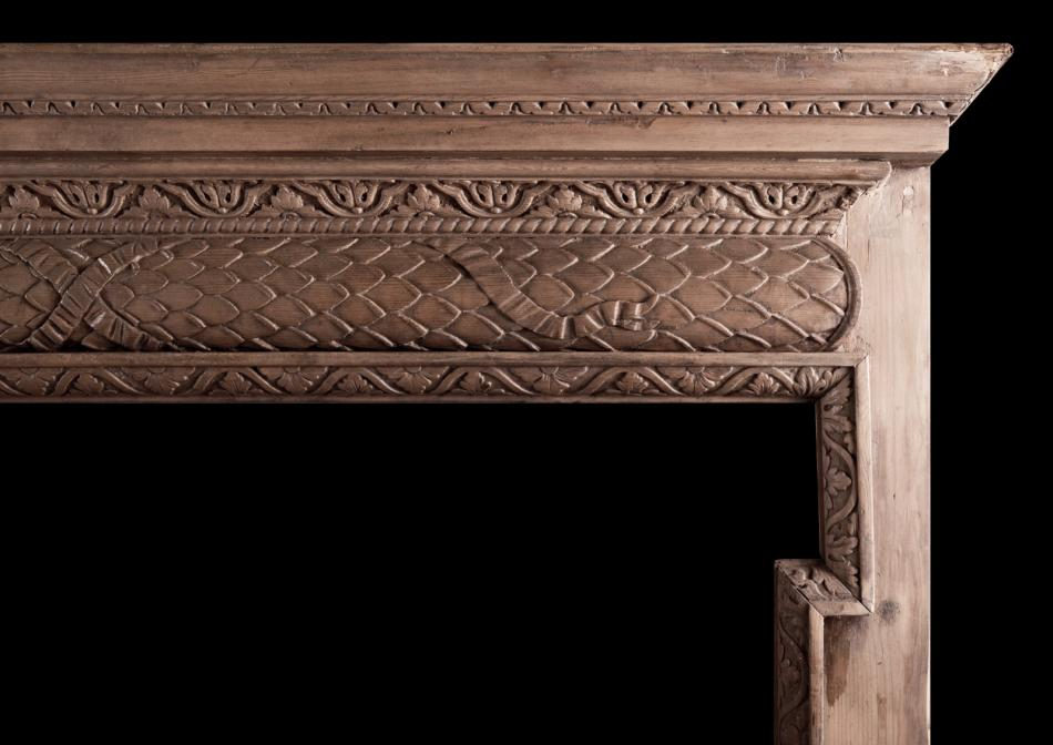 An English carved pine fireplace