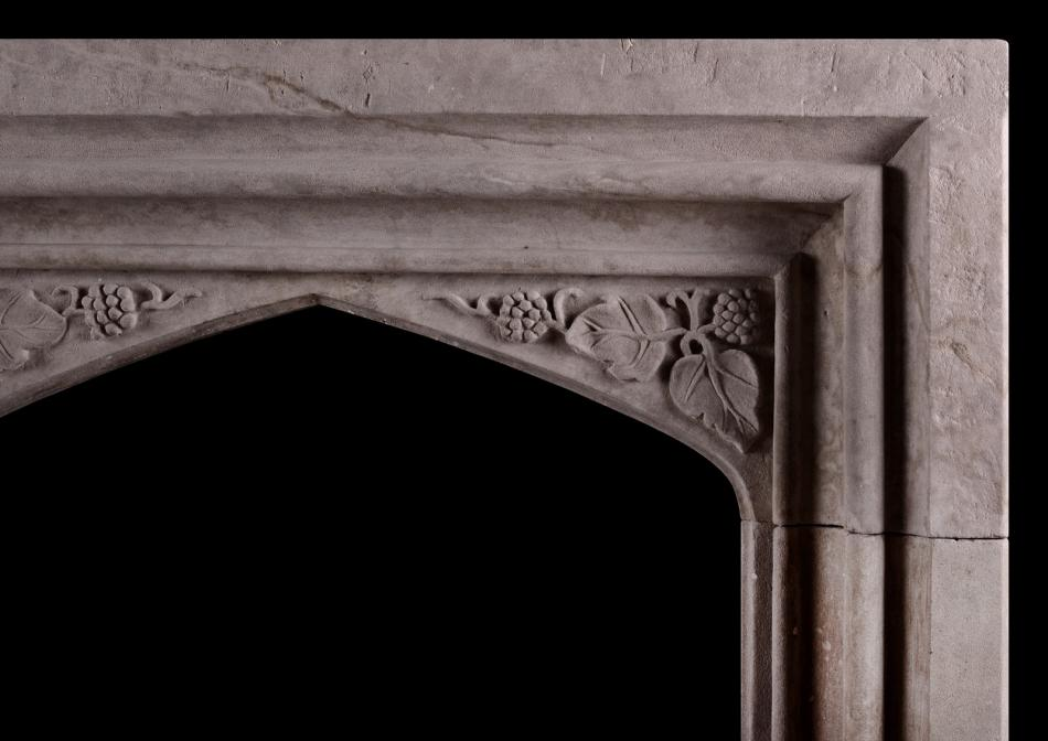 A carved stone fireplace in the Gothic manner
