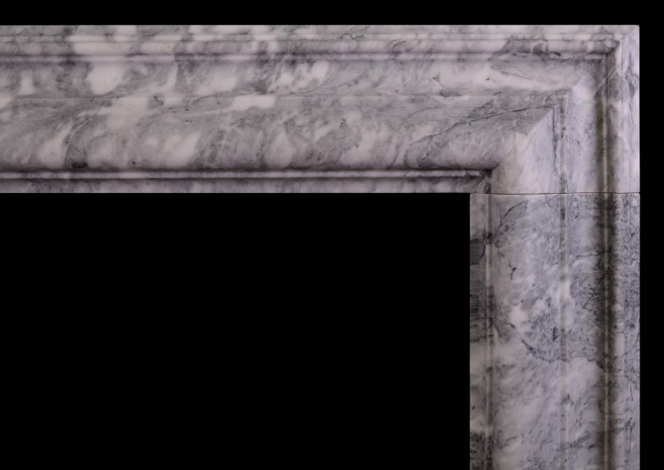 A grey and white marble bolection fireplace