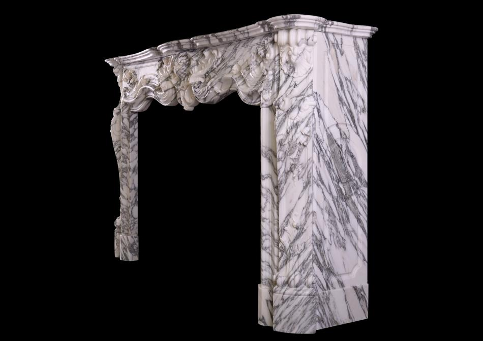 A Louis XV style fireplace in Italian Arabescato marble