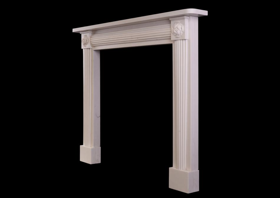 A white marble fireplace in the Regency manner