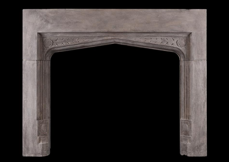 A stone fireplace in the Gothic manner